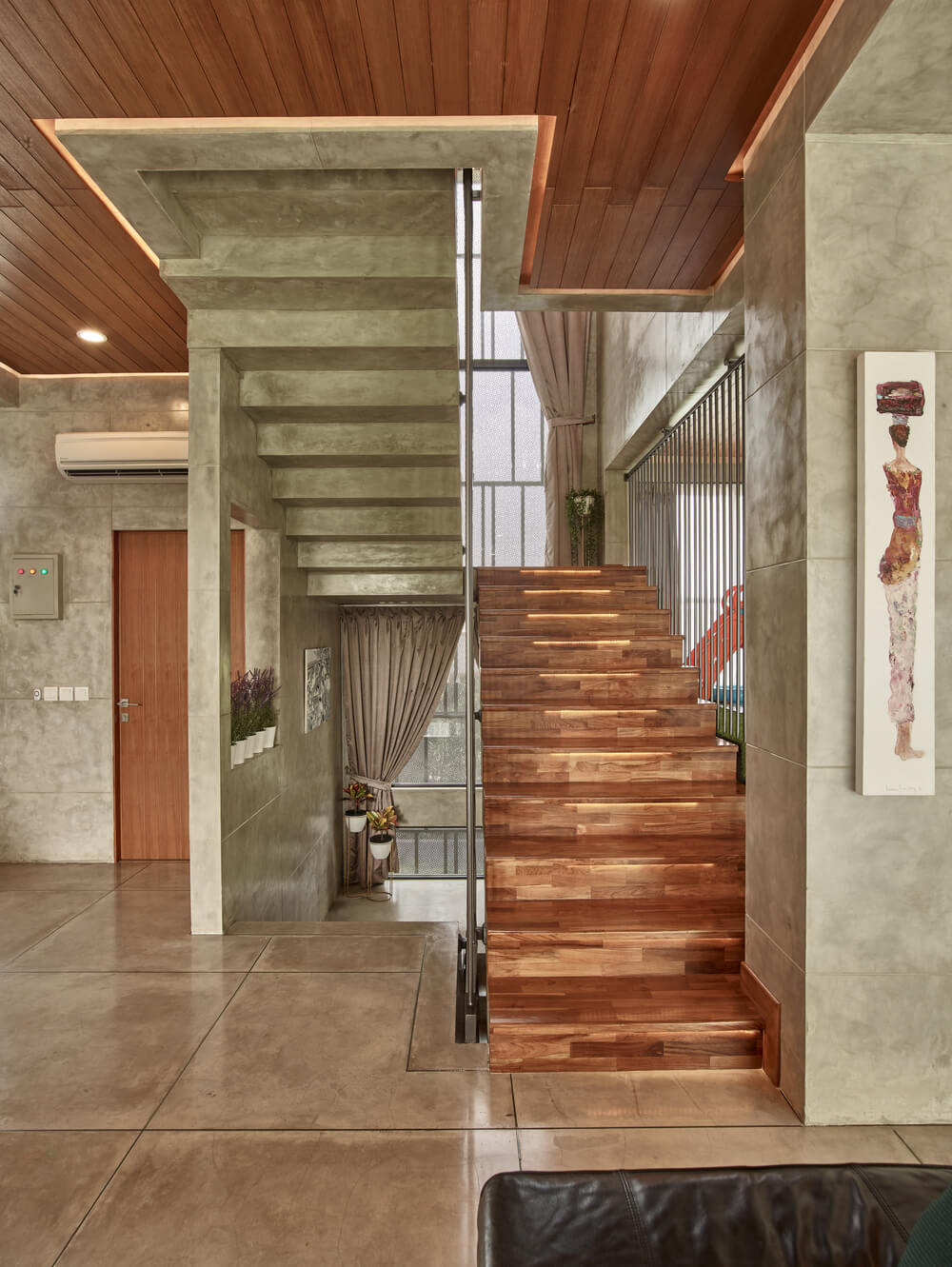 This is a view of the staircase from the vantage of the living room sofa.
