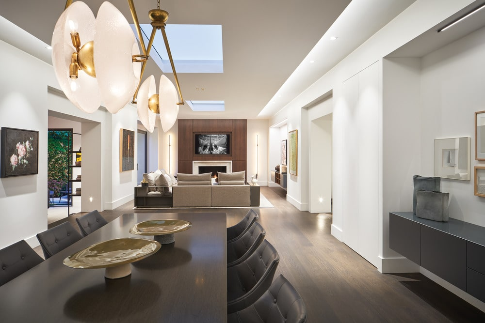 This is a close look at the formal dining area with a view of the formal living room on the far side.