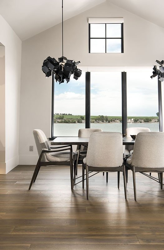 The dining area overlooks a breathtaking lake view.
