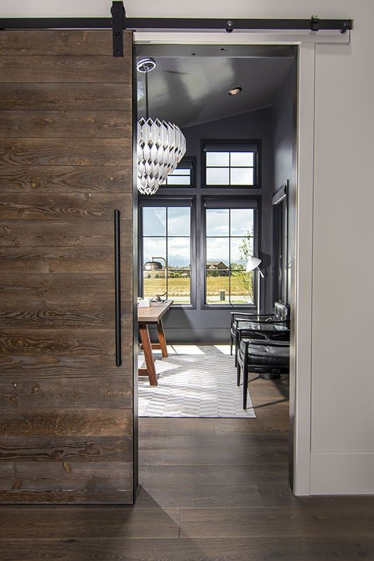 A large barn door slides open to the home office.