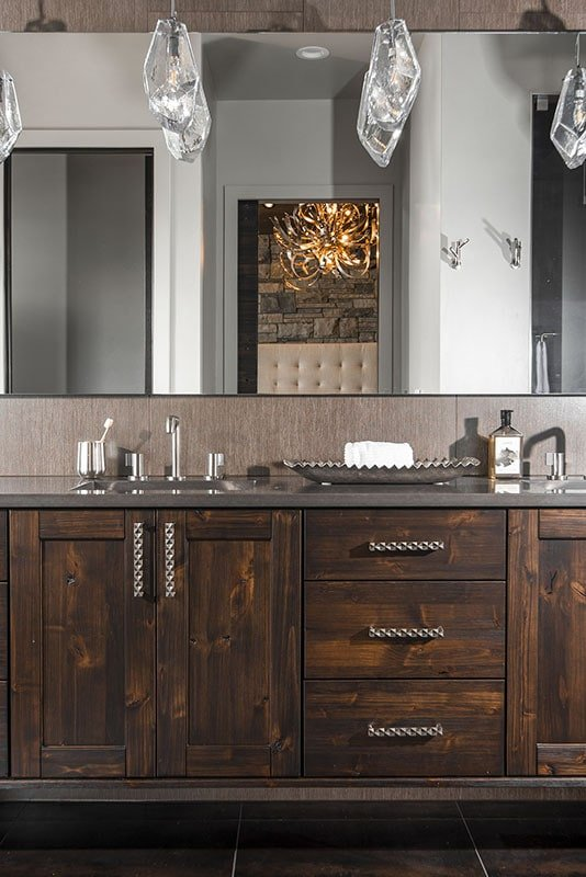 A close-up look at the wooden vanity with a double sink and a large rectangular mirror.