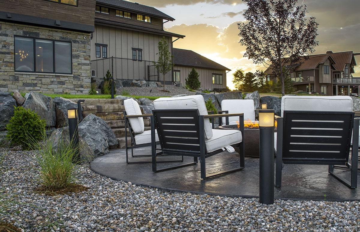 The yard has a fire pit seating complete with cushioned armchairs.