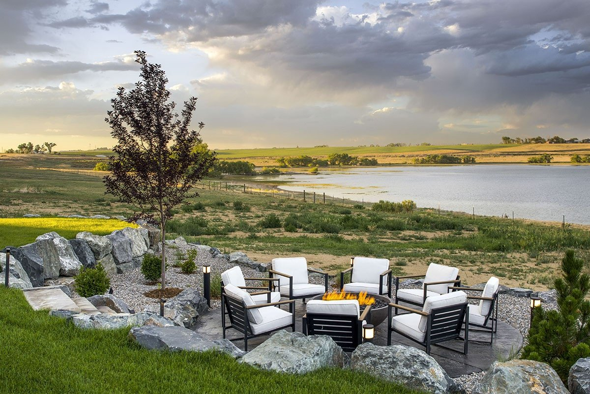 Beautiful boulders surround the sunken fire pit seating area.