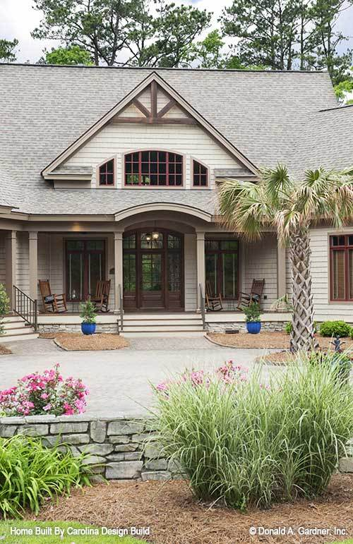 Home entry with a covered porch topped with a center gable.