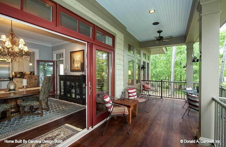 The rear porch includes sliding glass doors that open to the dining room.