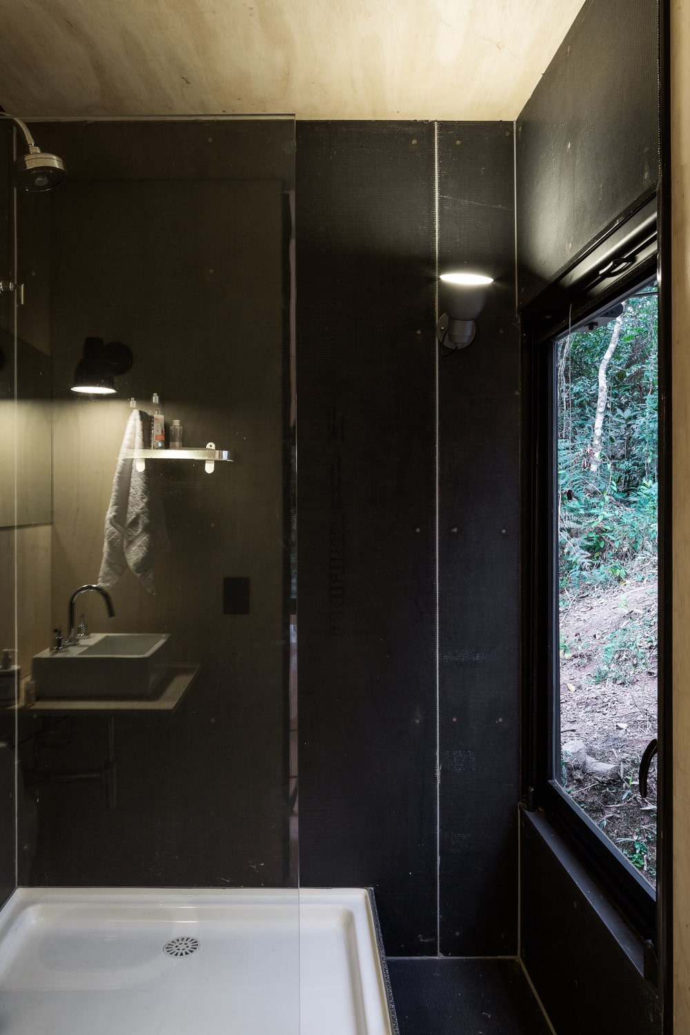 This is a close look at the glass-enclose shower area of the bathroom.