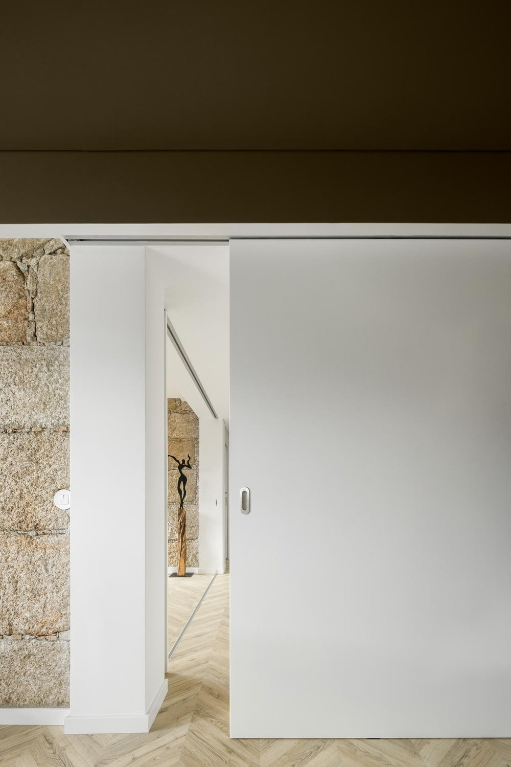 This hallway can be closed off with a hidden wooden sliding door.