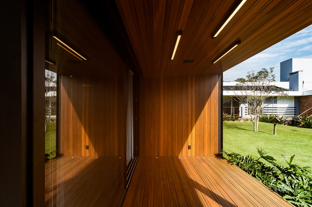 This is a closer look at the covered area with consistent wooden tones on its floor, walls and ceiling.