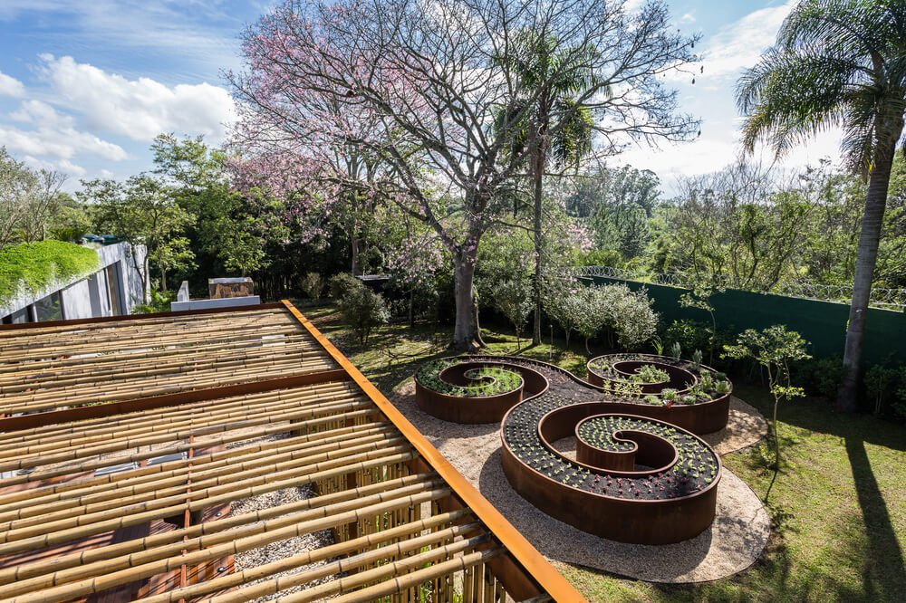 A few steps from the wooden deck patio is the garden that has a spiral design to it.