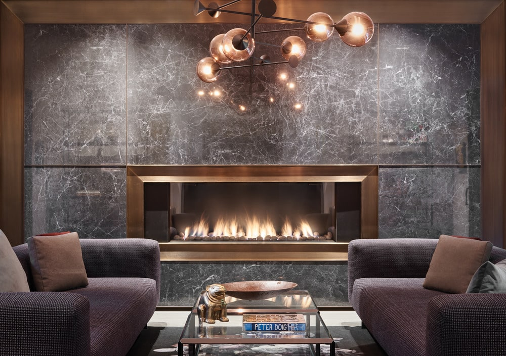 This is a close look at the family room that is highlighted by the modern glass-covered fireplace on the far side of the room.