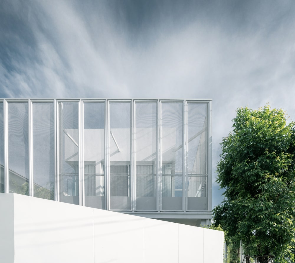 This closer look at the house showcases the support beams attached to the white concrete structure inside.