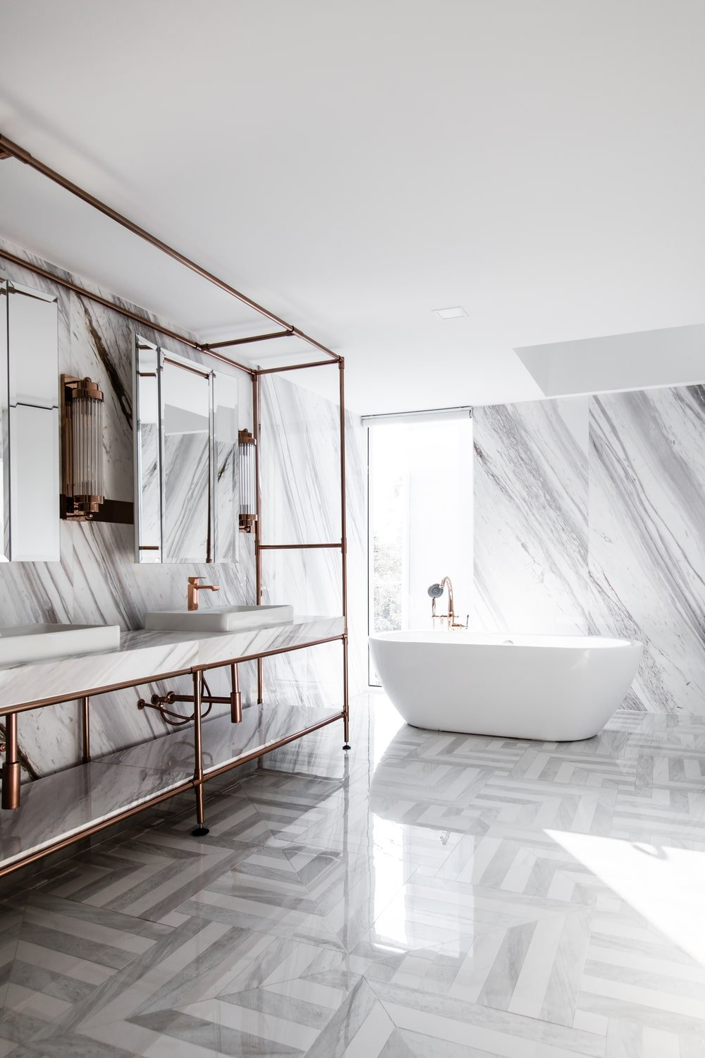 The natural lighting gives a shine to the white marble walls and patterned flooring tiles.