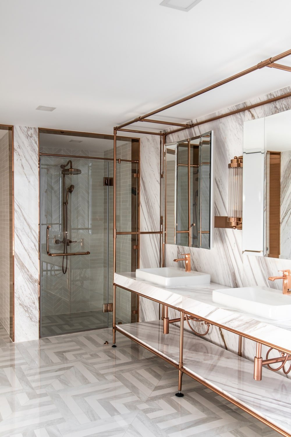 On the other side of the large two-sink vanity is the glass-enclosed shower area.