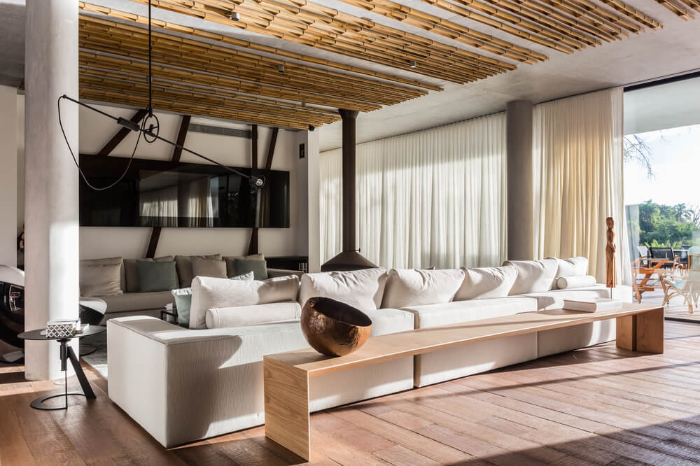 These are then complemented by the large wall-mounted TV on the far wall and the bamboo pieces on the ceiling above.