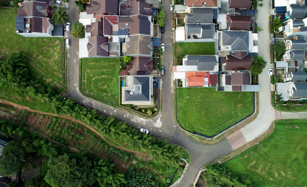 This is an aerial view of the house showcasing the neighborhood surrounding the house.
