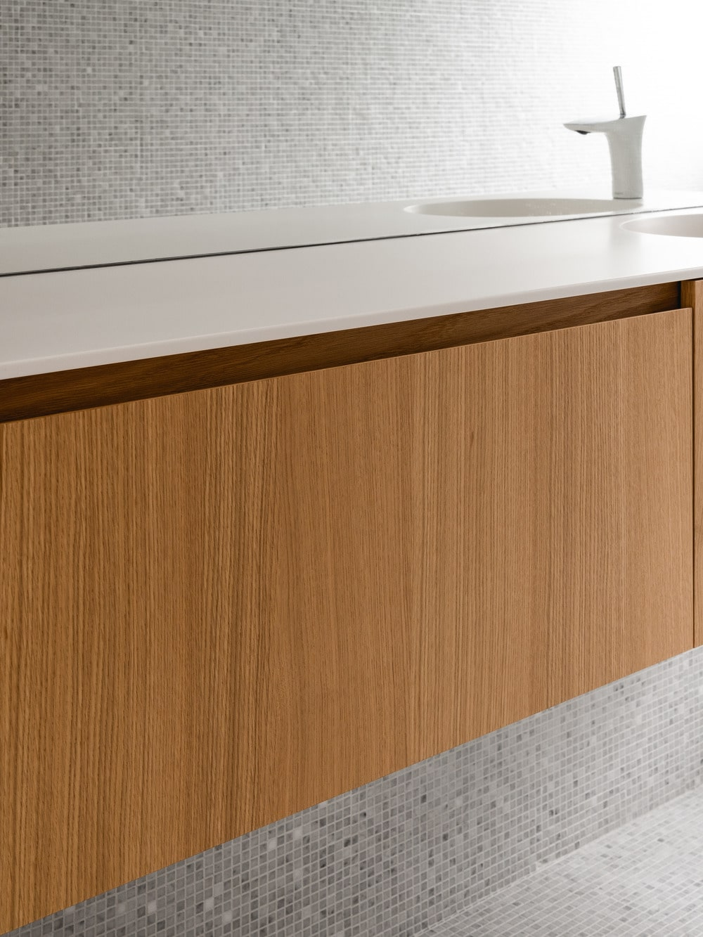 This is a close view of the floating shelf that has a wooden tone to contrast the light wall.