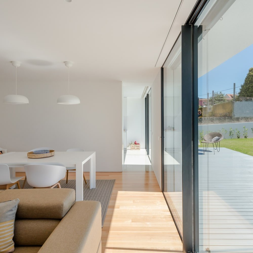 On the side of the living room is the large glass doors that open to the outdoor areas.