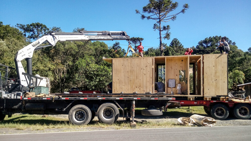 This is a view of the house during construction with its parts being delivered on a truck.