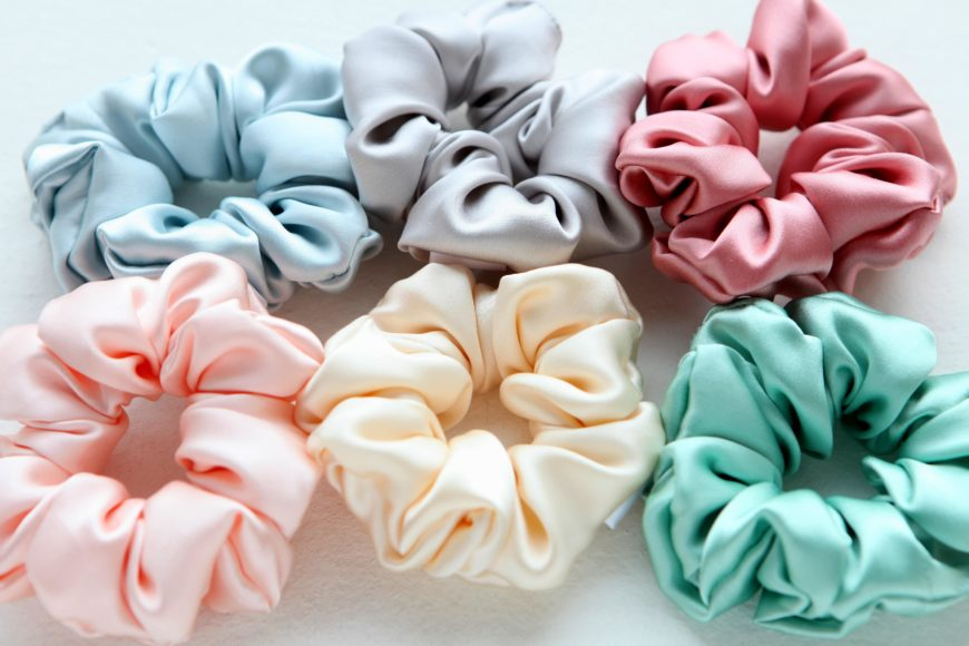 Different Colors of Silk Scrunchies on White Table
