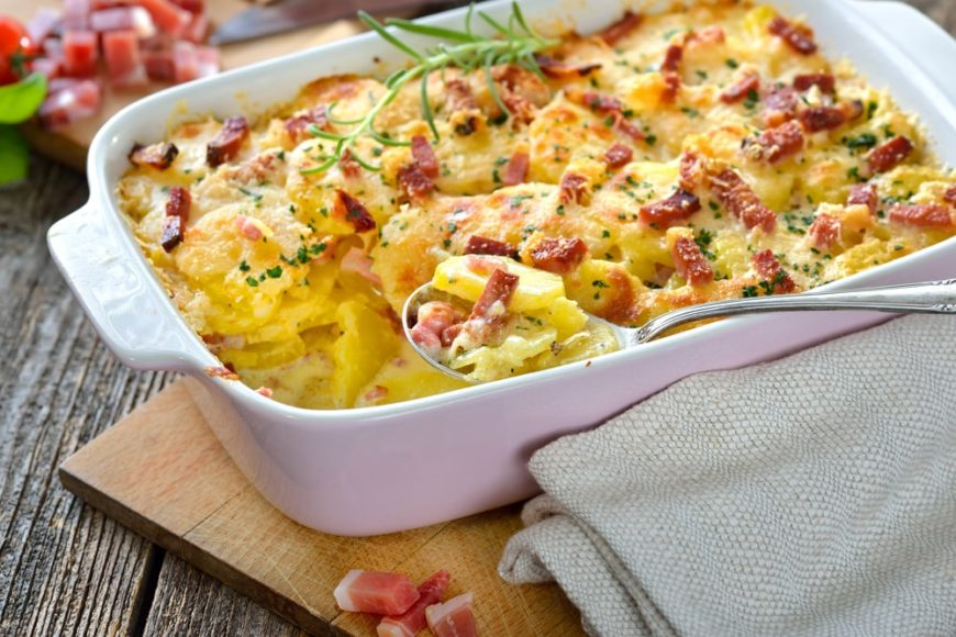 A large casserole dish filled with bacon cheesy potatoes.