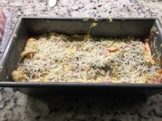The batter and cheese are placed into the Bread Pan.