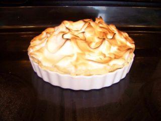 A freshly baked chocolate meringue pie.