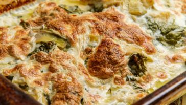 A close look at a freshly-baked cream cheese chicken and spinach casserole.