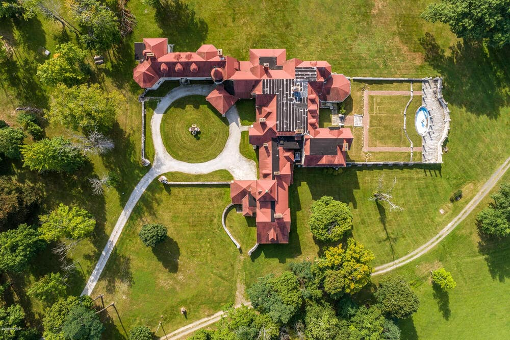 This is an aerial view of the massive main house of the property. You can also see here the large round driveway in front of the house. Image courtesy of Toptenrealestatedeals.com.