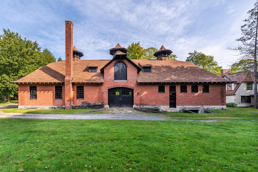 This is a close look at one of the buildings within the property with a terracotta tone to its exterior walls. Image courtesy of Toptenrealestatedeals.com.