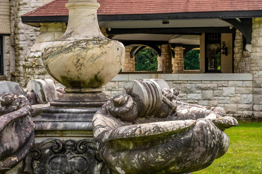 This is a closer look at the details of the vintage fountain in the front yard of the house across from the entry of the house. Image courtesy of Toptenrealestatedeals.com.