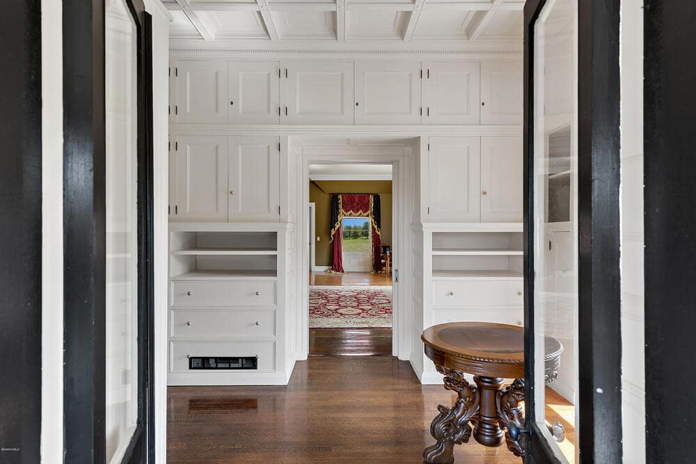 This is the large pantry that is connected to the kitchen. It also has multiple bright cabinetry to contrast the hardwood flooring. Image courtesy of Toptenrealestatedeals.com.