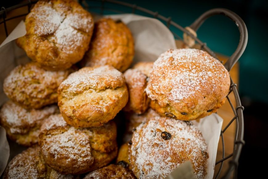 A basket full of ginger and pear scones.
