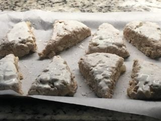 The half-cooked scones are covered with heavy cream.