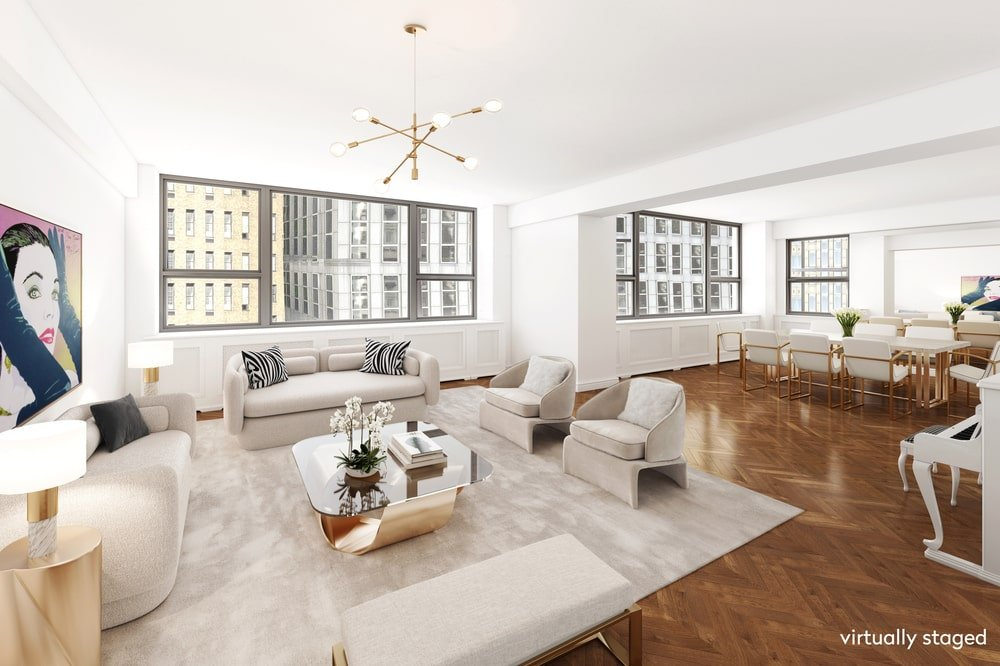 This is a view of the great room that houses the living room and informal dining area within its bright white walls and ceiling brightened by the large windows. Image courtesy of Toptenrealestatedeals.com.