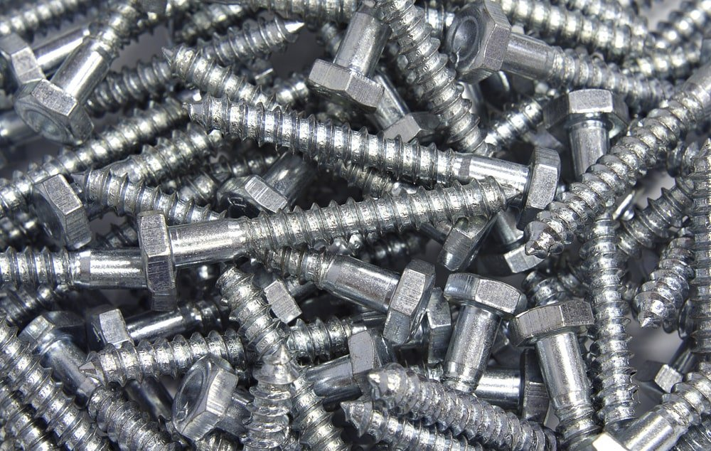 A close look at a pile of zinc plated lag screws.