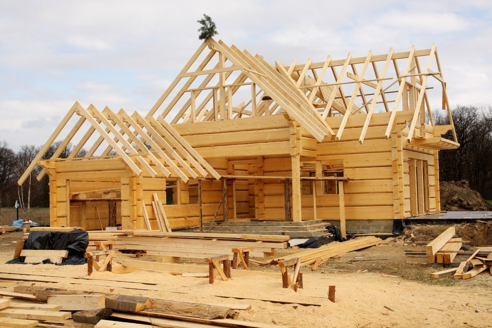 An unfinished house with wooden frames and beams.