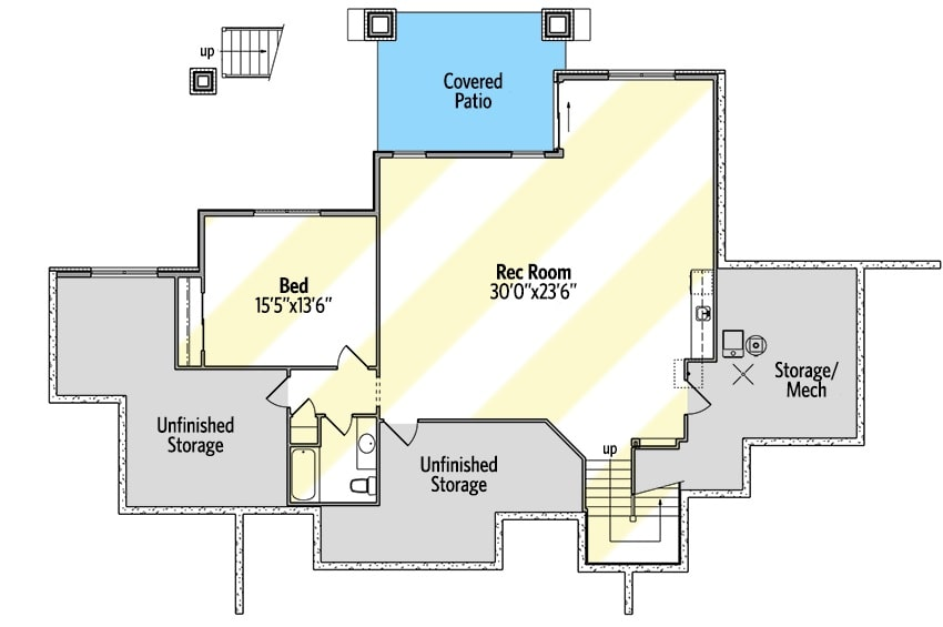 Lower level floor plan with a bedroom and a massive recreation room with a wet bar and patio access.