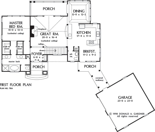 Main level floor plan of a two-story 3-bedroom The Sable Ridge mountain retreat home with front and rear porches, foyer, great room, dining room, kitchen with breakfast nook, primary suite, and a covered walkway leading to the angled garage.