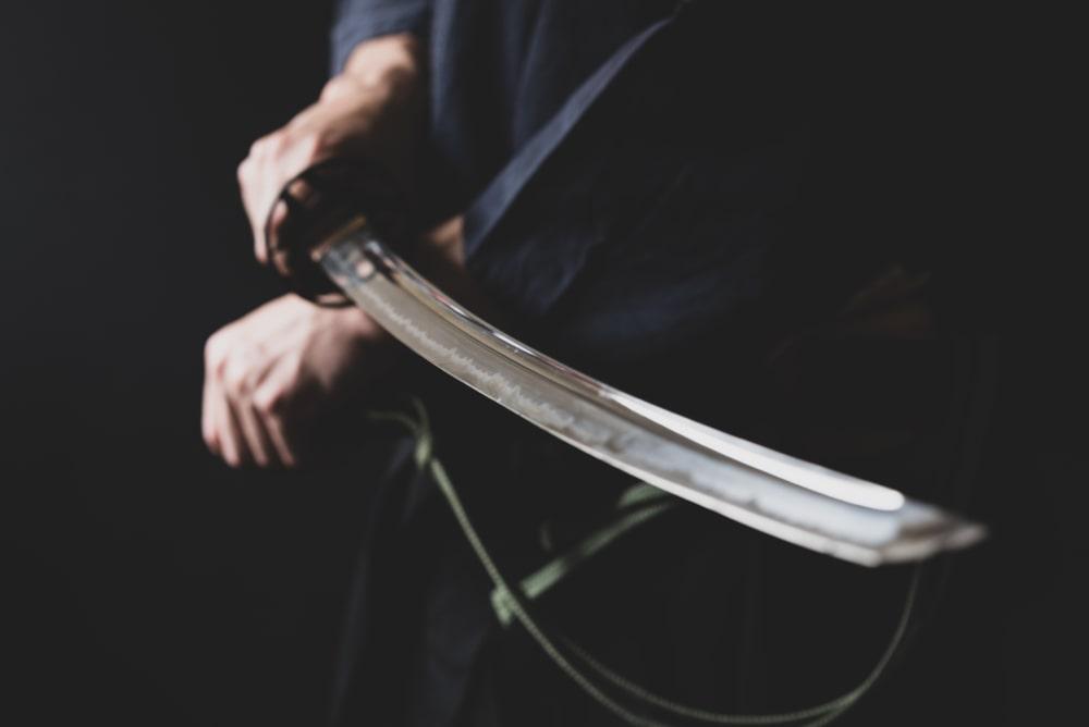 A close look at a samurai holding a katana.