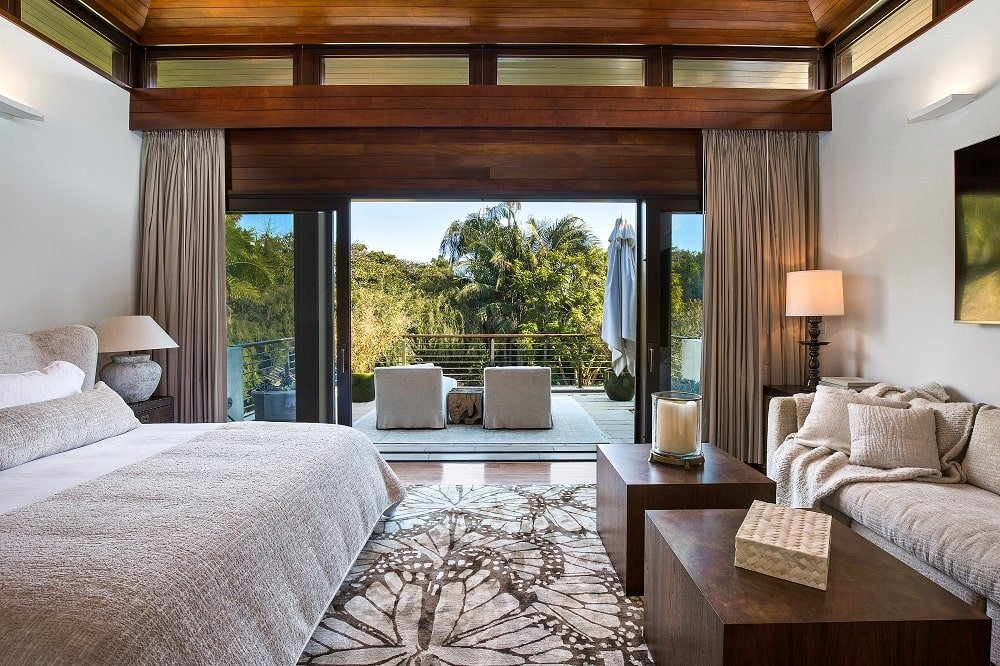 This other look at the bedroom showcases the sitting area across from the bed as well as the large terrace through the glass doors on the far side. Image courtesy of Toptenrealestatedeals.com.