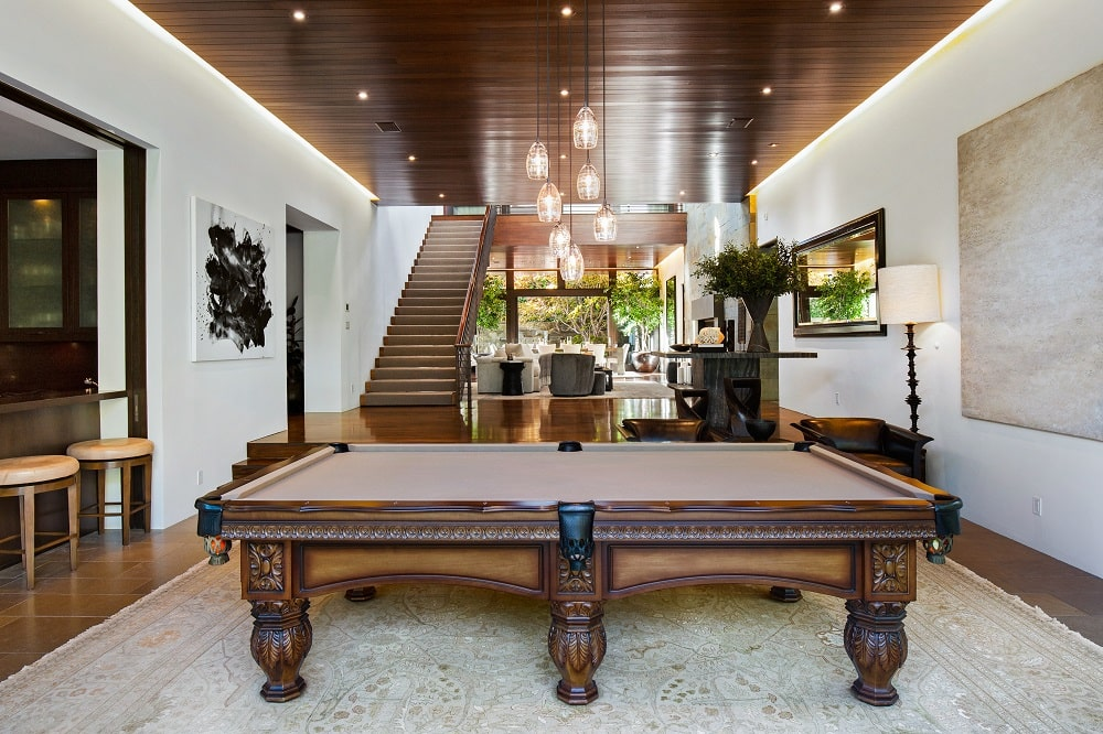 This angle showcases the proximity of the game area from the staircase and living room. Image courtesy of Toptenrealestatedeals.com.