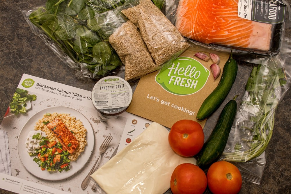 Hello Fresh meal kits packed in paper bags.