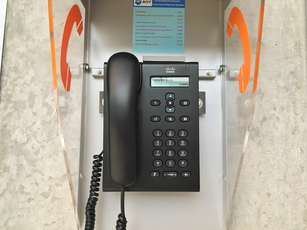 This is a close look at a modern phone booth mounted on the wall.