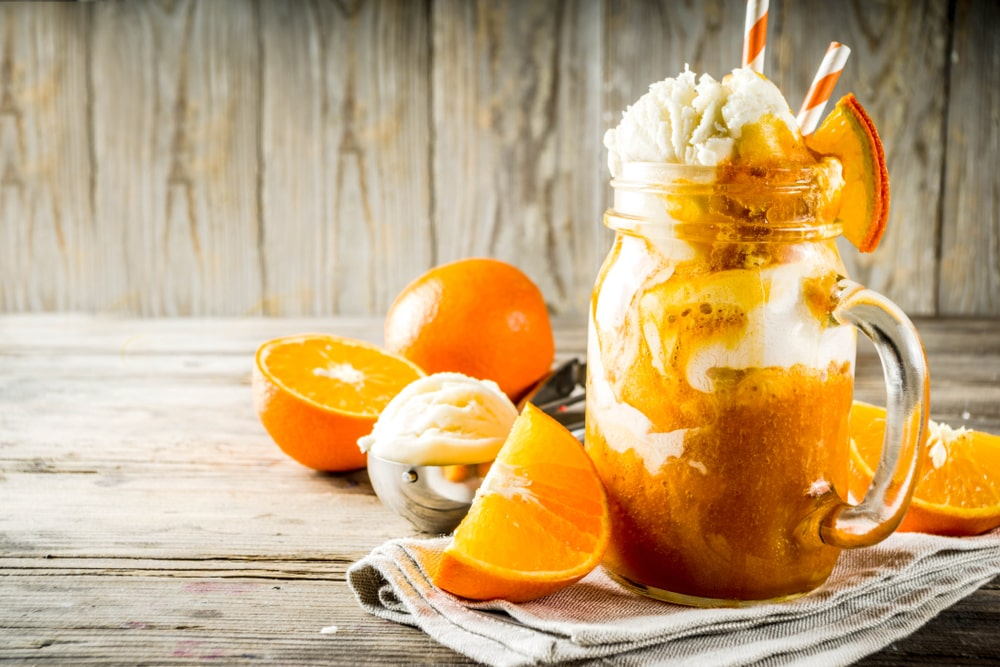 This is an orange dreamsicle salad in a mason jar.