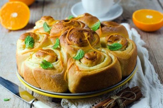 A plate of orange sweet rolls.