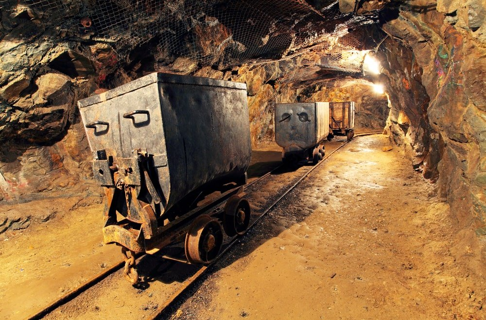 Mining cart passing through a tunnel.