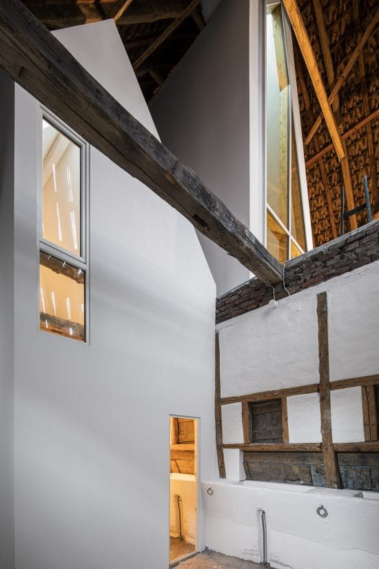 This is a close look at the interiors of the house that has bright walls and exposed wooden beams.