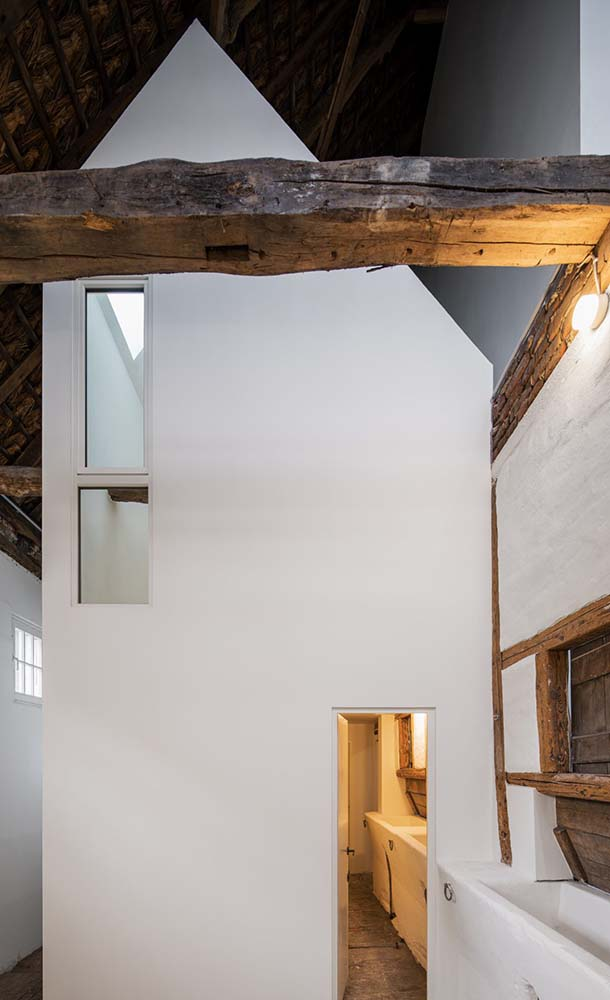 This angle of the house gives a nice contrast between the modern white walls and the rustic wooden beams.