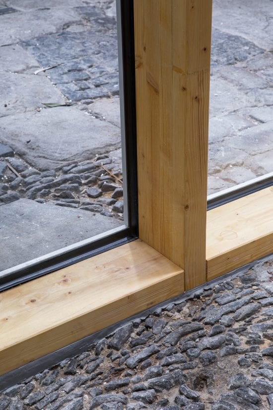 This is a close look at a wooden frame for the glass wall.