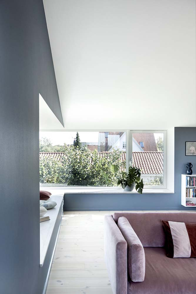 The interior of the large window has a built-in bench for a perfect reading nook.